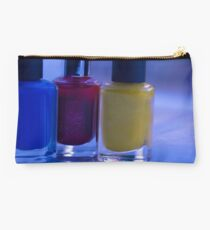 Close up of blue, red and yellow nail polish Studio Pouch