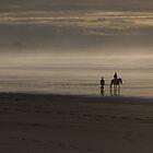 Horse rider on misty beach by Duncan Cunningham