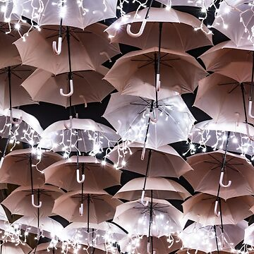 The beauty of white umbrellas illuminated by Christmas lights decorating the streets of Agueda Portugal by AnaMOMarques