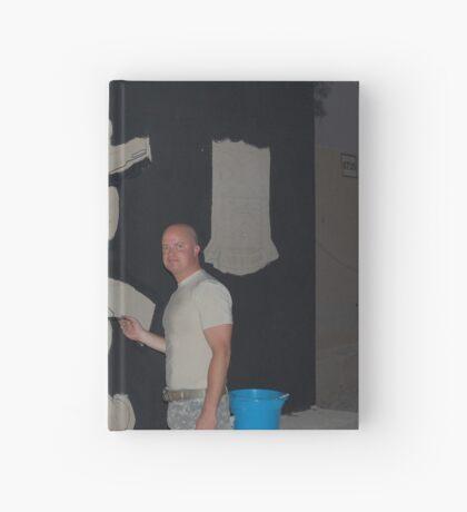 Josh King painting T-wall in Balad Iraq Hardcover Journal