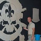Josh King painting T-wall in Balad Iraq by 1SG Little Top