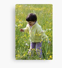 A happy child among the flowers Canvas Print