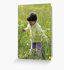 A happy child among the flowers Greeting Card