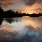 setting sun, pitfour loch by codaimages