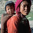 Tibetan woman with her baby by Kerry Dunstone