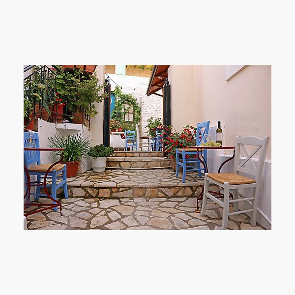 Wine and grapes on the table street in Parga Greece Photographic Print