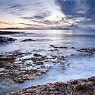 Morning Sunrise Over Rocks by Kye Vincent