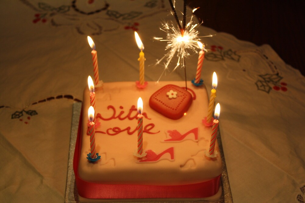 Victorias Sixteenth Birthday Cake Complete With Candles and a