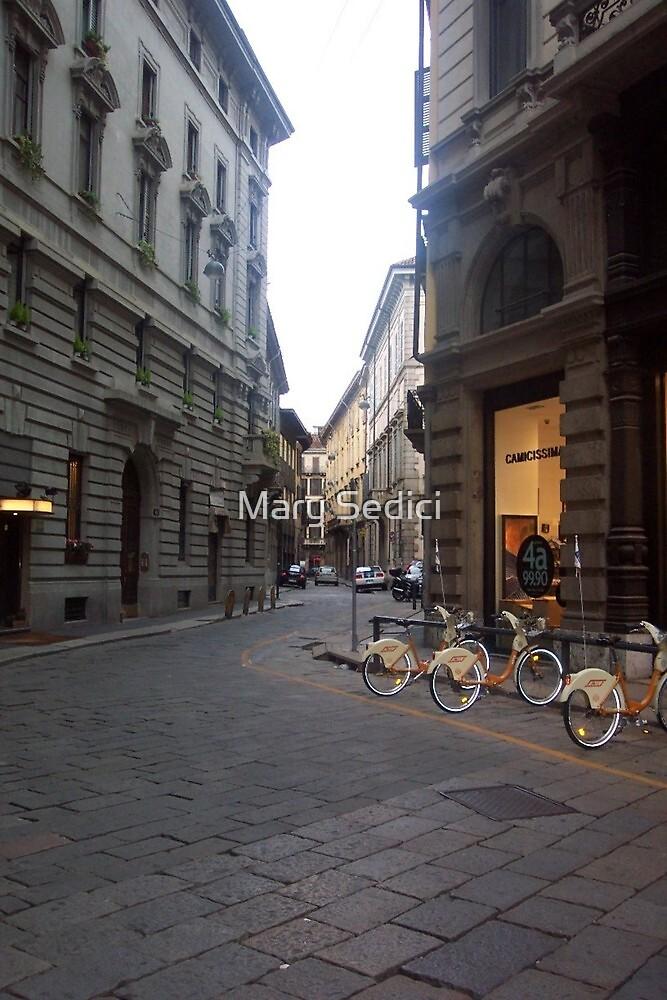 Narrow Street in  a Wide Citi-  Milan, Italy  by Mary Sedici