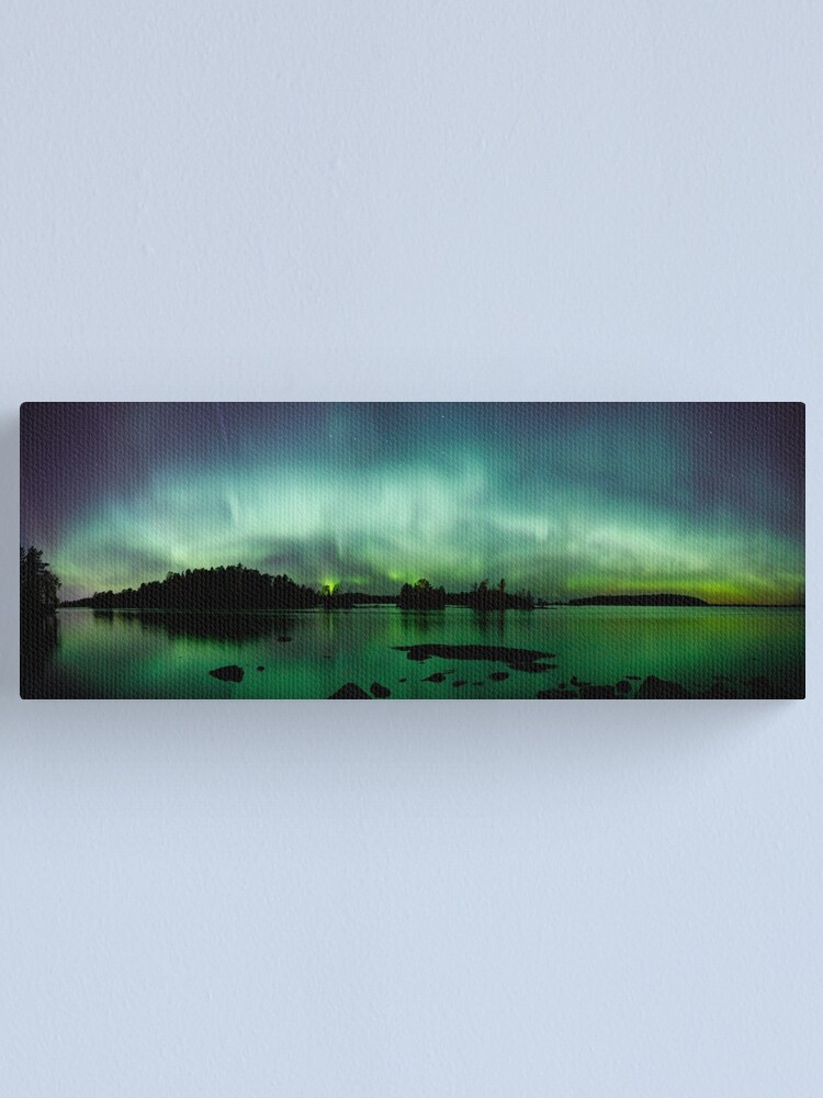 Alternate view of Beautiful northern lights over lake panorama Canvas Print