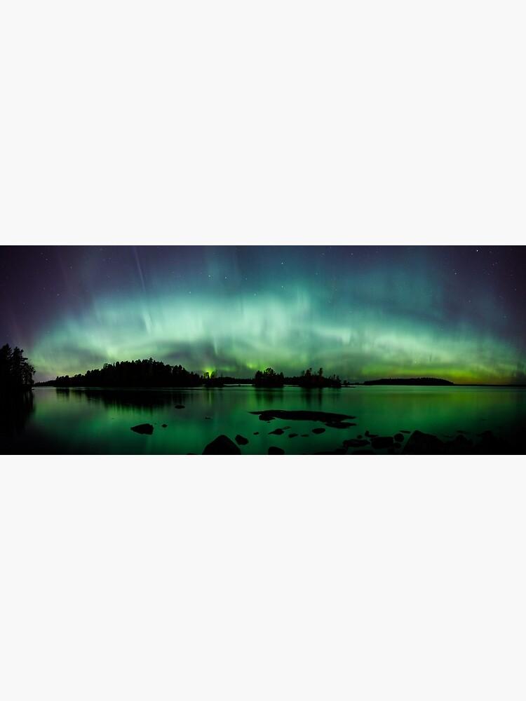 Beautiful northern lights over lake panorama by Juhku