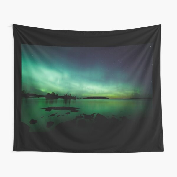 Beautiful northern lights over lake Tapestry