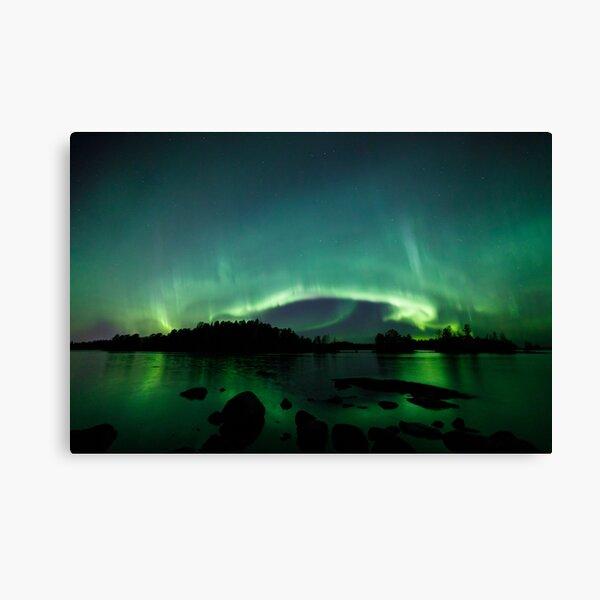 Beautiful northern lights over lake Canvas Print