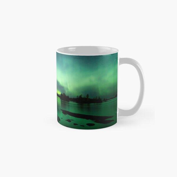 Beautiful northern lights over lake Classic Mug