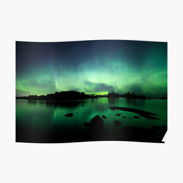 Beautiful northern lights over lake Poster
