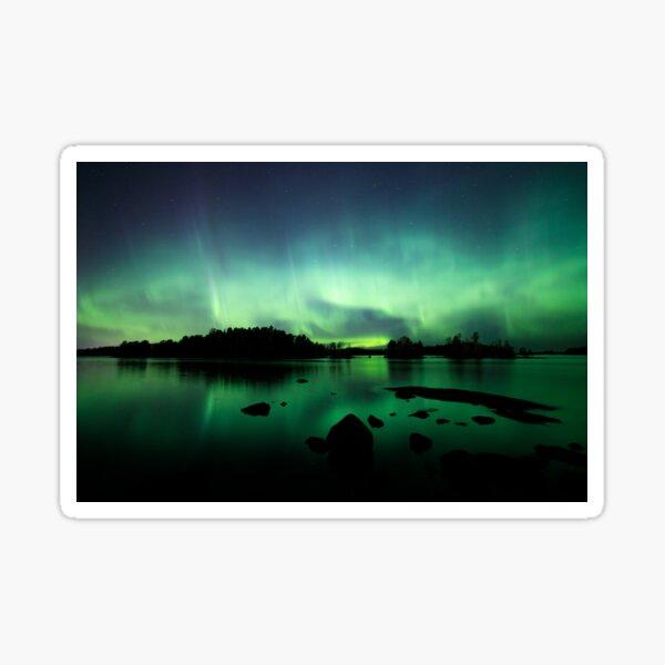 Beautiful northern lights over lake Sticker