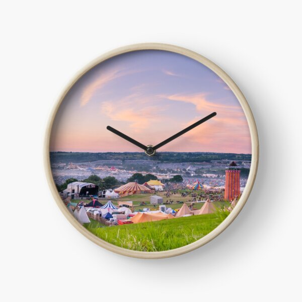 Glastonbury Festival at Sunset Panorama with Tipis Clock