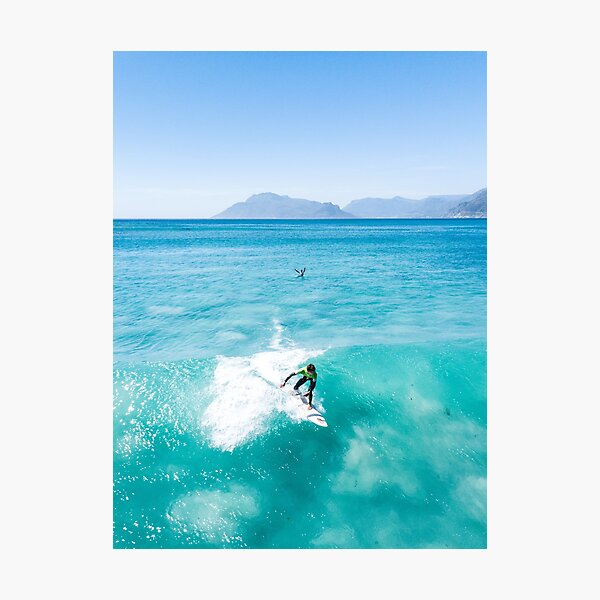 Surfer catching a crystal clear wave - Drone shot Photographic Print