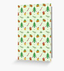 Christmas tree, toy train, Xmas gift, bells and smiling star in a joyful pattern Greeting Card