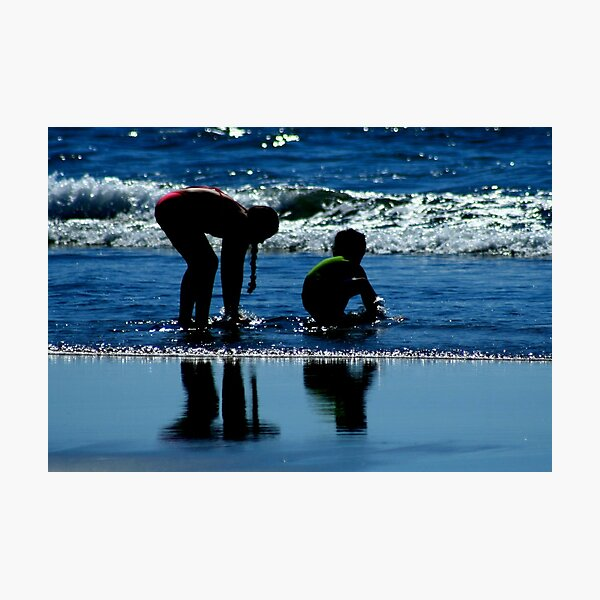 two children playing in the ocean waves by CheyAnne Sexton Photographic Print