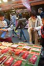 Buying octopus in Tokyo by Glen O'Malley