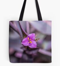 Macro Photograph of a Tiny Purple Pink Flower and Purple Leaves Tote Bag