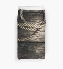 Nautical rope on boat deck. Maritime knots Duvet Cover