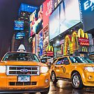 Taxis in Times Square, New York by Cathy Grieve