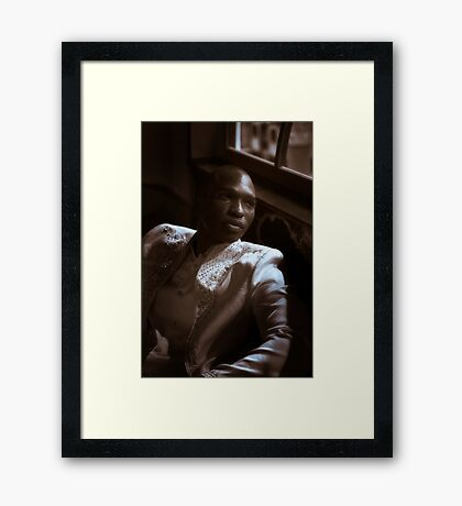 The Man in the Cream Suit Framed Print