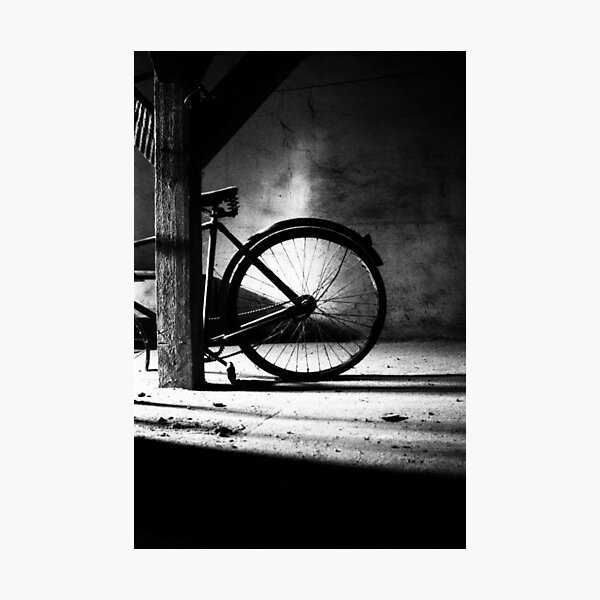 Old bicycle in a dusty attic Photographic Print