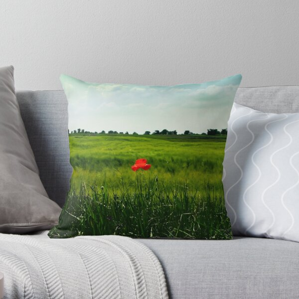 Grassy field with a poppy Throw Pillow