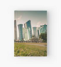 Doha skyline and sunset Hardcover Journal