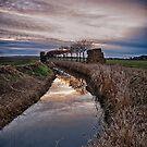 Landscape of The Marsh At Sundown by Dave Godden