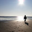 boy on the beach by poppykitten