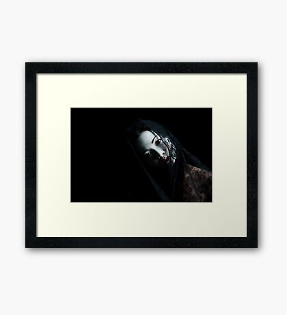 What lays behind these eyes? Framed Print
