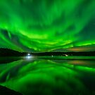 Vibrant Aurora Reflection Over Lake by Aaron Lojewski
