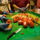 Cooks Chopping Red Capsicums by edesigned