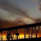 Sunset On The Huey P. Long Bridge Railroad  by Wanda Raines
