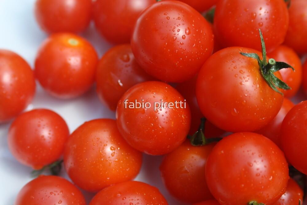red tomatoes by fabio piretti