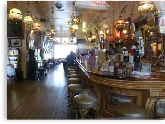 Haunted? What sits on the 2nd bar stool in front? by Elaine Bawden