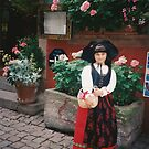 Riquewihr, Alsace - pretty little lass in traditional costume by BronReid