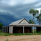 Storm brewing behind the old Wilber Stables by pedroski