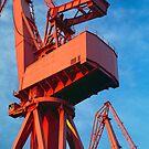 Red dockyard cranes by Alex Ramsay