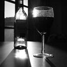 Wine in black & white at night by Brett Wall