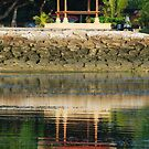 Balinese pagoda reflecting in the sea by Michael Brewer