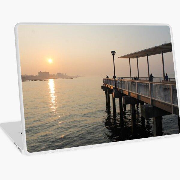 #sunset #water #sea #pier #beach #dusk #reflection #sky #lake #outdoors #landscape #horizontal #yellow #colorimage #sunrisedawn #nopeople #sun #sunny #watersedge #coastline #nonurbanscene Laptop Skin