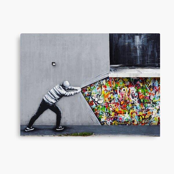 Banksy uncovering graffiti Canvas Print