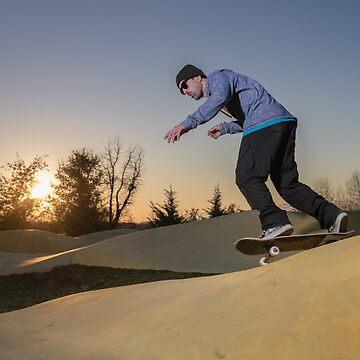 Skateboarder on a pump track park by homydesign