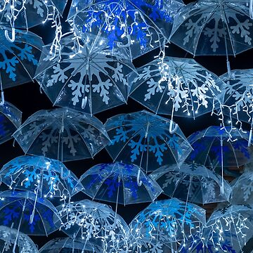 White umbrellas iluminated by Christmas lights by homydesign