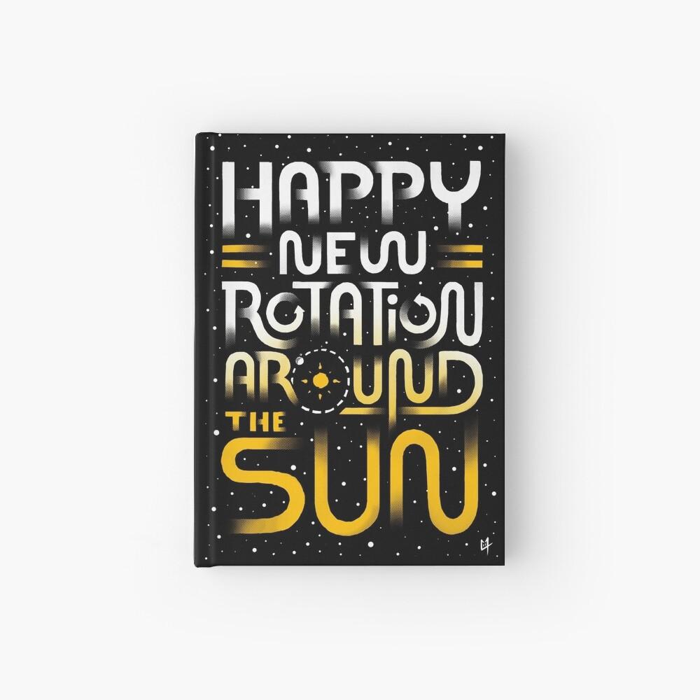 Glückliche neue Drehung um die Sonne Notizbuch
